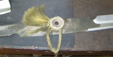 Rope tangled in mower blade and spindle