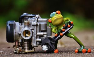 Mechanic Frog Toy Figure Working On A Carburetor